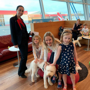 Dogs and Young Travellers at the Airport